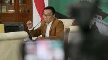 Jokowi Teken Omnibus Law, Emil Ajak Warga Dewasa Berdemokrasi