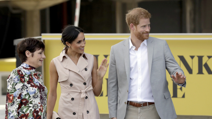 Meghan Markle is pretty in pink in $825 sleeveless trench dress
