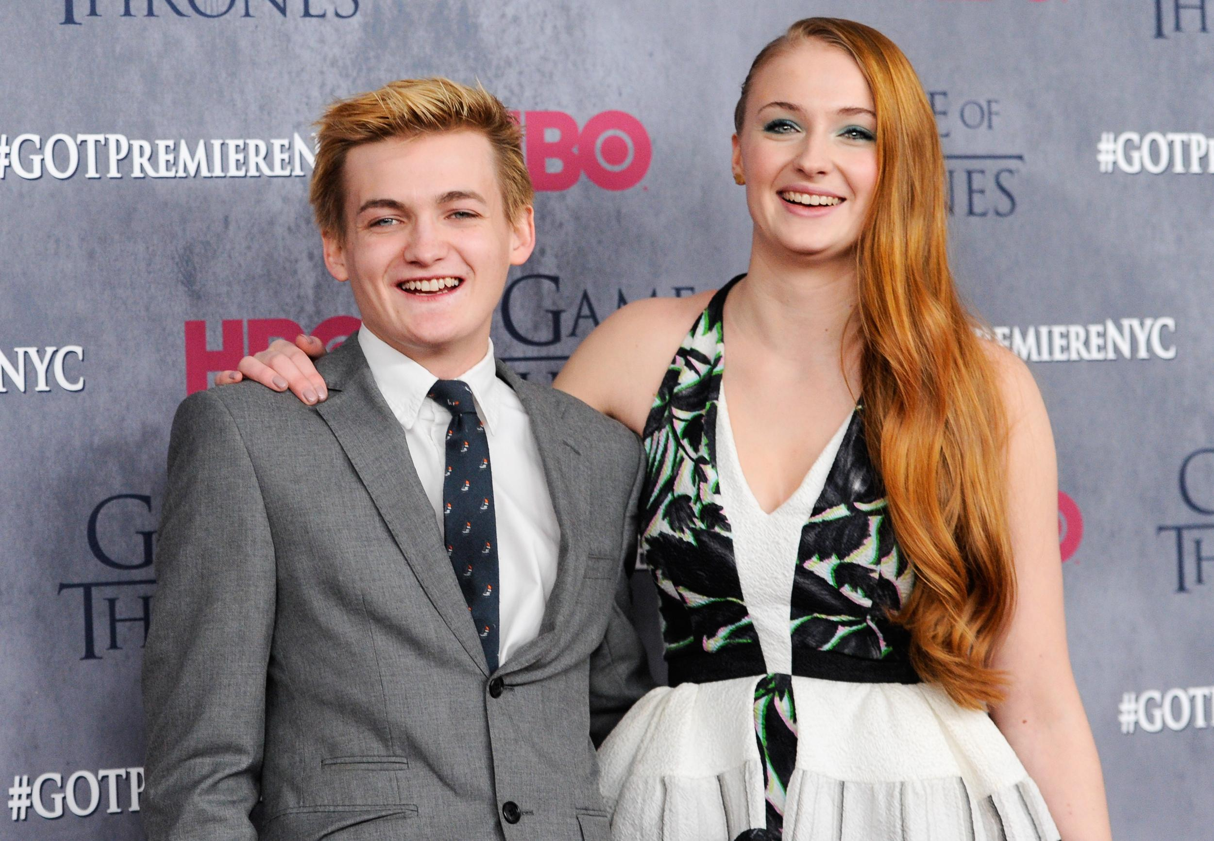 """Actors Jack Gleeson and Sophie Turner attend HBO's """"Game of Thrones"""" fourth season premiere at Avery Fisher Hall on Tuesday, March 18, 2014 in New York. (Photo by Evan Agostini/Invision/AP)"""
