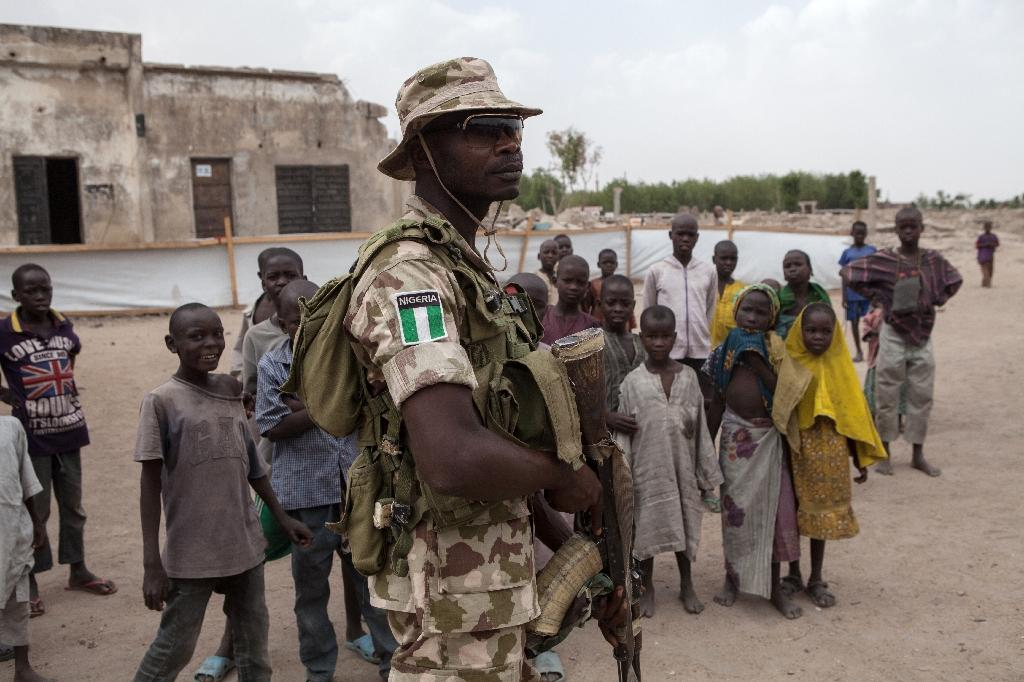 A Nigerian soldier on patrol in Banki, in the northeastern state of Borno, a region where Boko Haram insurgents are especially active (AFP Photo/FLORIAN PLAUCHEUR)