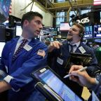 Dow closes above 23,000 as IBM surges