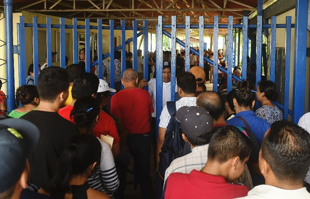 Nicaraguans queue at a migration office in Managua attempting to escape the country's violent upheaval