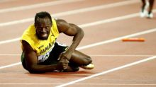 Usain Bolt falls to the ground during final race of career