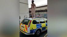 Naked man filmed dancing on police car near Bristol