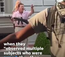 Prosecutor launches investigation after white couple seen pointing guns at St. Louis protesters