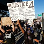 Demonstrators rally over death of George Floyd, who died in police custody