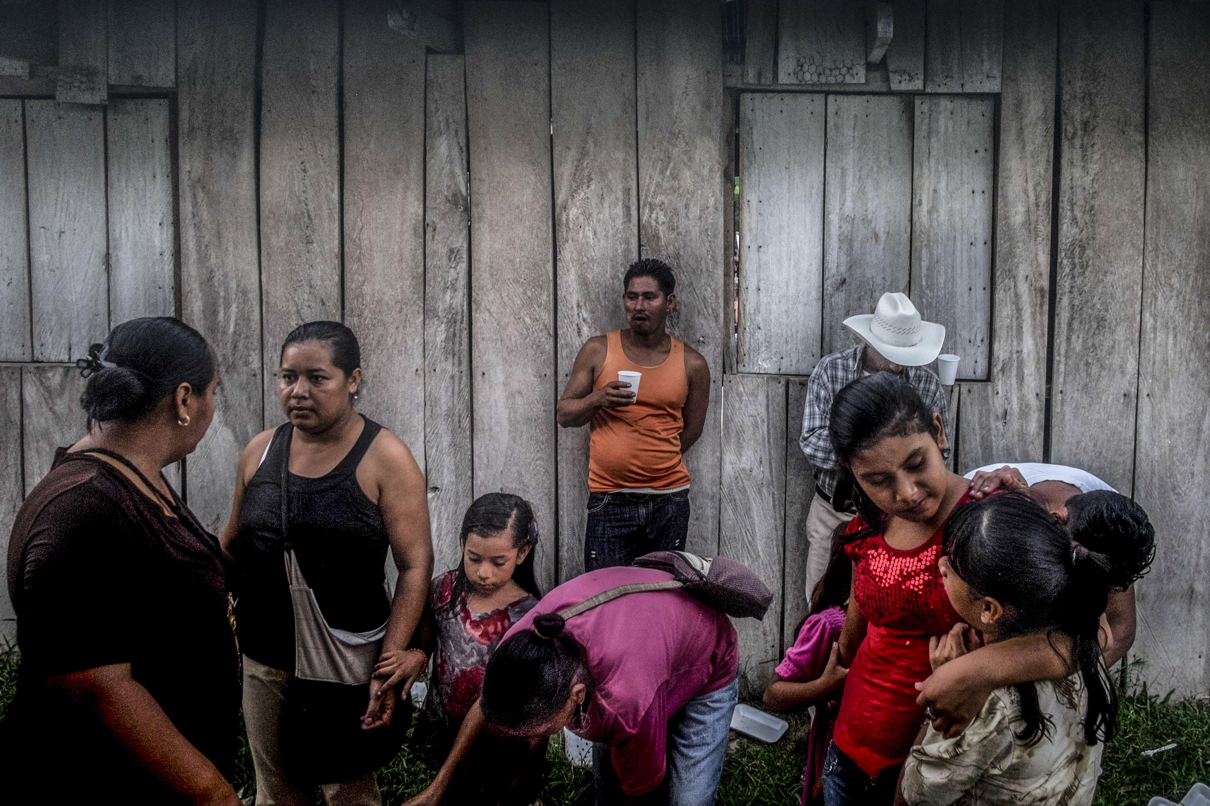 <p>Members of the small community of Guadalupe Carney, near the city of Tocoa, Bajo Aguán region, Honduras. Another sector that has suffered a disproportionate number of attacks are peasants groups engaged in land conflicts with large agro-business enterprises – for instance, in the Bajo Aguán, where more than 100 campesino land rights activists have been killed during a drawn-out conflict with the Dinant Corporation. (Photo: Francesca Volpi) </p>