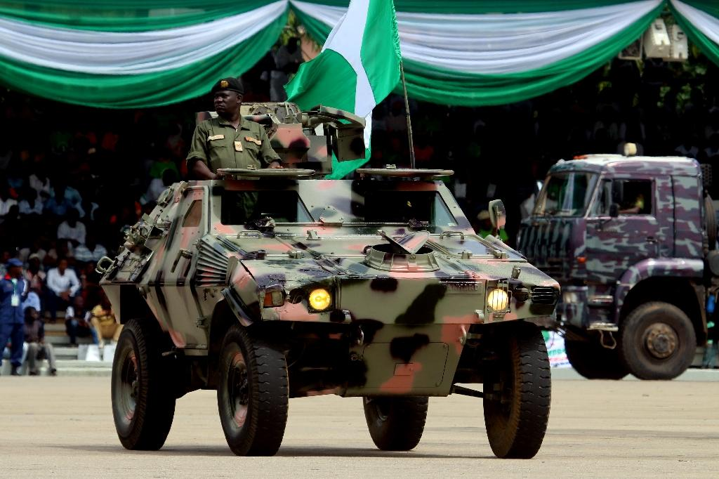Nigeria's army, seen here parading vehicles, confirmed eight troops had been killed in a militant attack over the weekend (AFP Photo/Sodiq ADELAKUN)