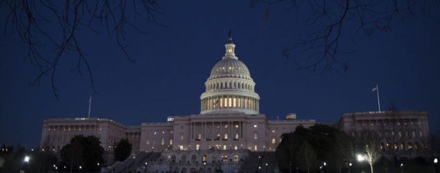 With no apparent indications of a breakthrough in the Senate to avoid a government shutdown on Jan. 19, the Capitol is illuminated in Washington. (AP)