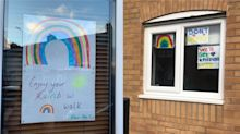 Children are painting rainbows to place in their windows to raise the spirits of passers-by
