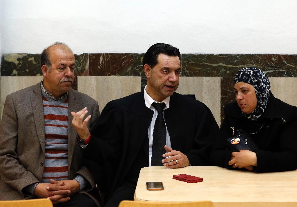 Hussein and Suha (R), the parents of late Palestinian teenager Mohammed Abu Khdeir, talk with their lawyer Mohannad Gbara in a courtroom at a Jerusalem district court on January 13, 2016 (AFP Photo/Ahmad Gharabli)