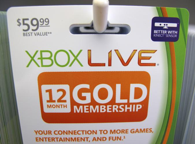 Xbox live gold membership cards are shown for sale at a Microsoft retail store in San Diego January 18, 2012. Microsoft Corp's fiscal second-quarter profit fell very slightly as lagging computer sales to cash-strapped consumers in the United States and Europe hurt its core Windows business. Picture taken January 18, 2012. REUTERS/Mike Blake (UNITED STATES - Tags: BUSINESS SCIENCE TECHNOLOGY)