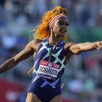 The Latest: Richardson breezes to win in 100 meters