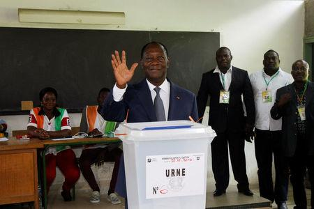 Ivory Coast's President Alassane Ouattara waves after his vote at a polling station of the lycee St Marie during a referendum on a new constitution, in Abidjan, Ivory Coast October 30, 2016. REUTERS/Luc Gnago