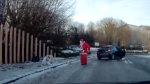 Santa to the rescue - Father Christmas helps pedestrian after tumble on icy pavement