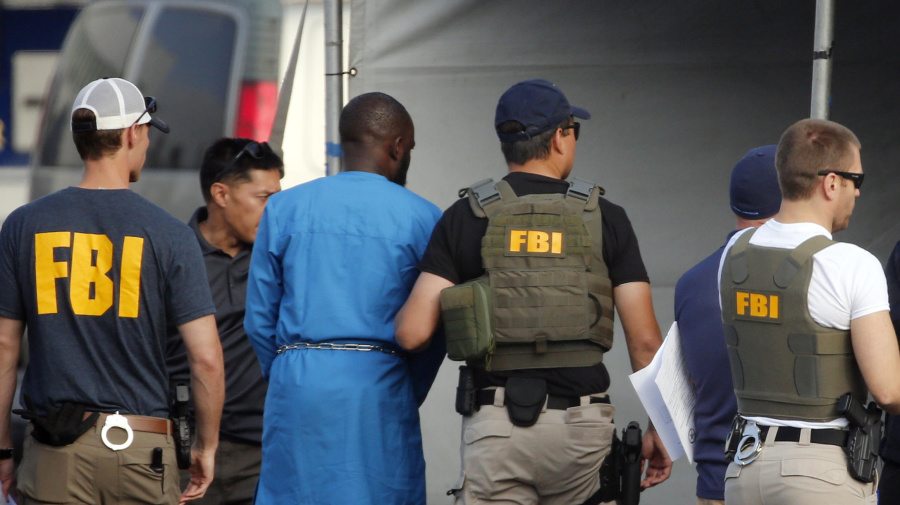 Feds indict 80 in fraud, money laundering scheme