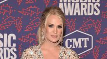 Carrie Underwood Lights Up the Red Carpet in Gold Diamanté Sandals at 2019 CMT Music Awards