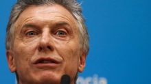 Macri vows to win second term after Argentine peso crashes on primary results