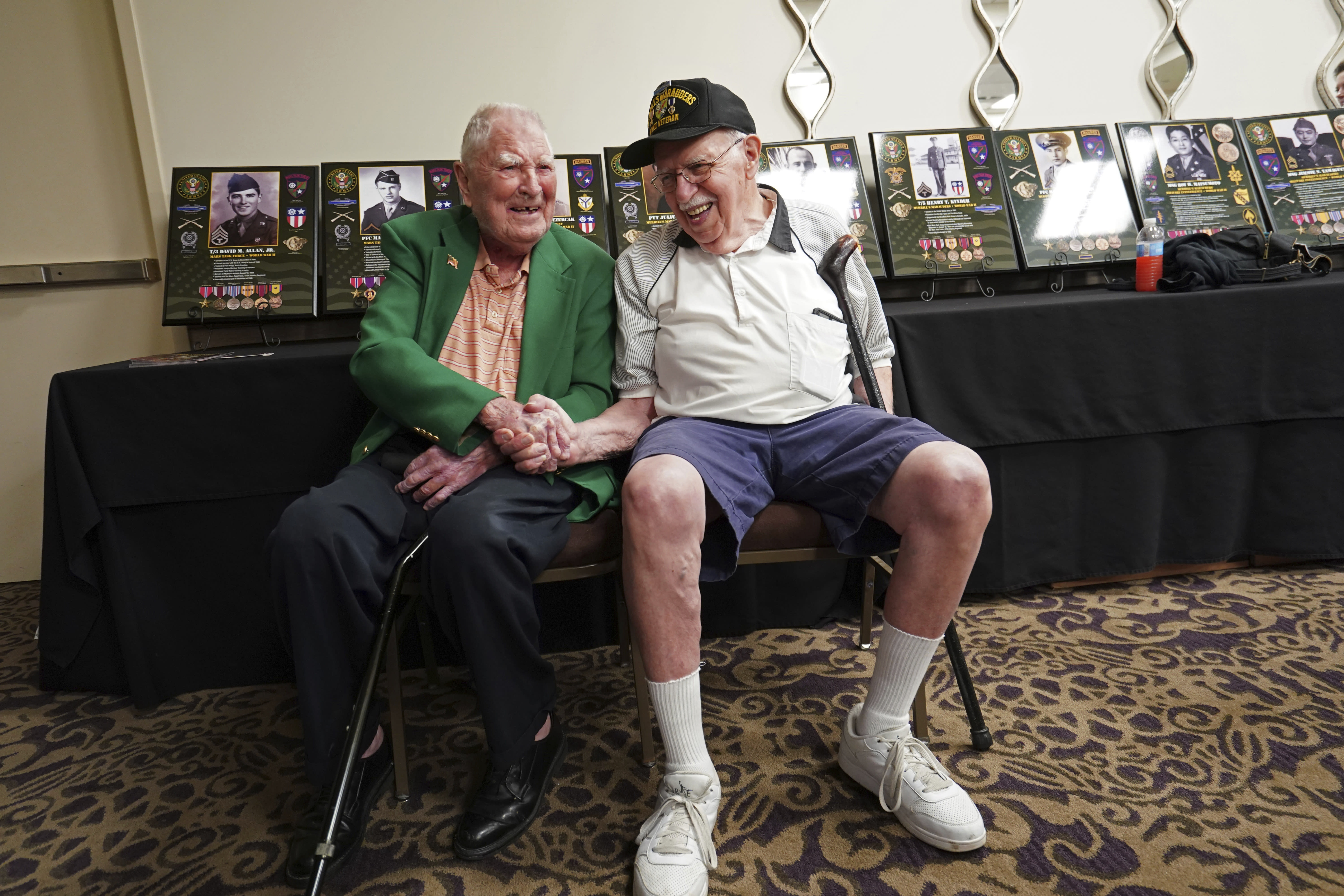 FILE - In this Aug. 28, 2018 file photo, surviving members of the famed WWII Army unit Merrill's Marauders, David Allan, of Rockhill SC, left, and Robert Passanisi, of Lindenhurst NY, shake hands during a gathering of remaining members, family and history buffs, in New Orleans. The unit that spent months marching and fighting behind enemy lines in Burma has been approved to receive the Congressional Gold Medal, Congress' highest honor. Nearly 3,000 soldiers began the unit's secret mission in Japanese occupied Burma in 1944. Barely 200 remained in the fight when their mission was completed five months later. (AP Photo/Gerald Herbert, File)