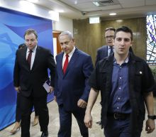 The Latest: Israeli education minister to stay in government
