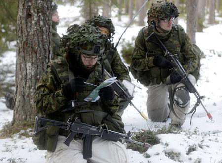Estonian army conscript soldiers attend a tactical training in the military training field near Tapa