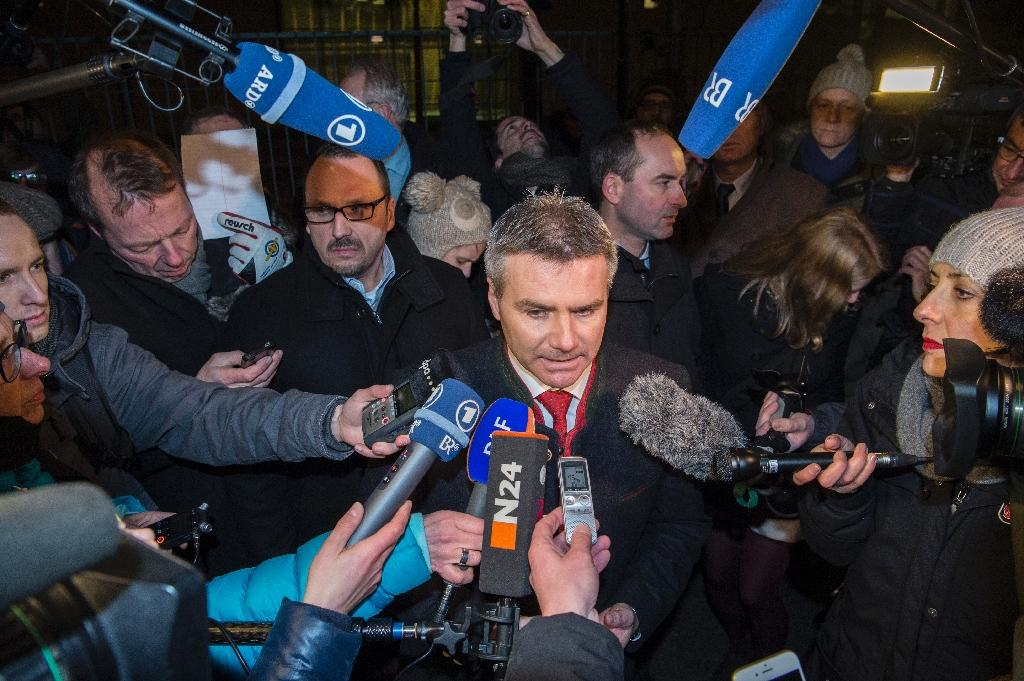 German Bavarian Landshut district administrator Peter Dreier speaks to reporters in Berlin on January 14, 2016, after he chartered a bus to take 31 refugees from the Bavarian city of Landshut to the Chancellery (AFP Photo/John MacDougall)