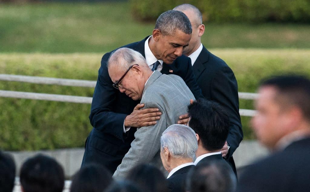 US President Barack Obama hugs Shigeaki Mori, a survivor of the atomic bombing of Hiroshima, at the Hiroshima Peace Memorial Park cenotaph on May 27, 2016 (AFP Photo/Johannes Eisele)