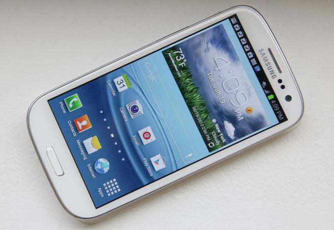 This June 19, 2012 photo shows Samsung's new Galaxy S III phone, in New York. The Galaxy S III, which looks and feels like an oversized iPhone, is available next week. (AP Photo/Bebeto Matthews)