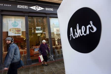 A woman leaves Ashers bakery in Belfast