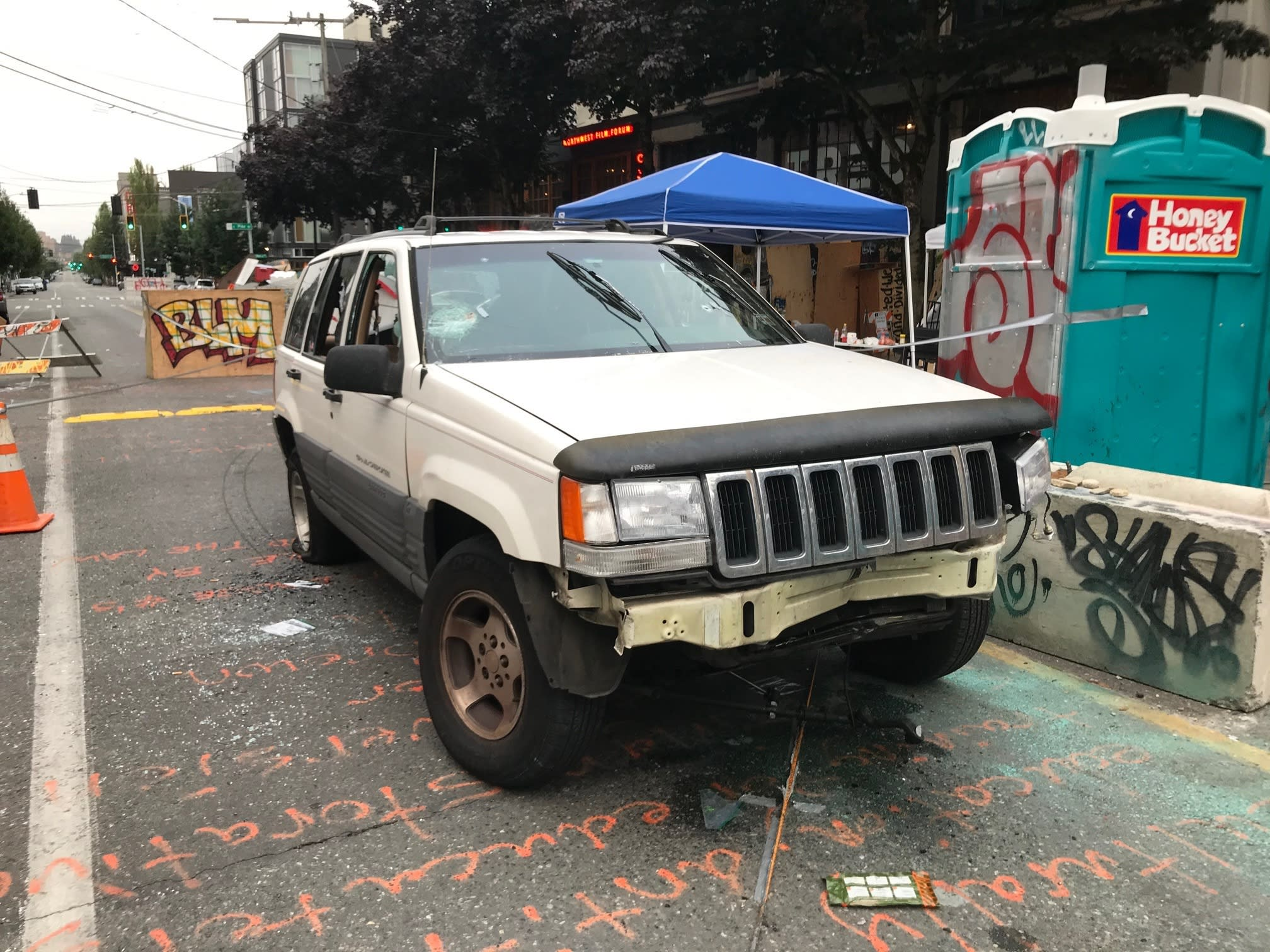 A car sits in the Capitol Hill Organized Protest zone following a shooting in Seattle early Monday, June 29, 2020. At least one man was killed and another was wounded early Monday morning when they were shot in the protest area known as CHOP, after driving the vehicle into the area. (AP Photo/Aron Ranen)