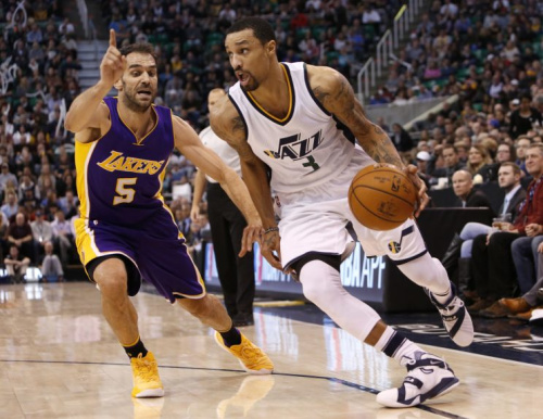 Jose Calderon attempts to stop George Hill by technicality. (AP)