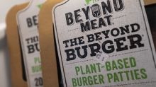 UPDATE 2-Restaurant Brands dishes up profit beat on product launches at Burger King