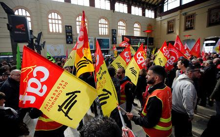 Railway workers hold CGT labour union flags as they demonstrate inside the Gare Saint-Charles train station on the second day of a nationwide strike by French SNCF railway workers, in Marseille, France, April 4, 2018. REUTERS/Jean-Paul Pelissier