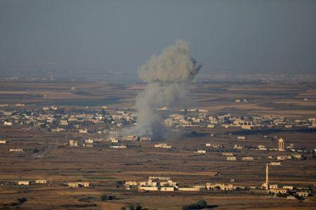 Smoke following an explosion in Syria is seen from the Israeli-occupied Golan Heights near the Israeli Syrian border July 16, 2018. REUTERS/Ronen Zvulun