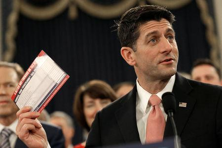 Speaker of the House Paul Ryan (R-WI) holds a sample tax form as he unveils legislation to overhaul the tax code on Capitol Hill in Washington