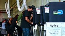 """""""Mon vote pourrait faire la différence"""": divisée, l'Amérique va aux urnes"""