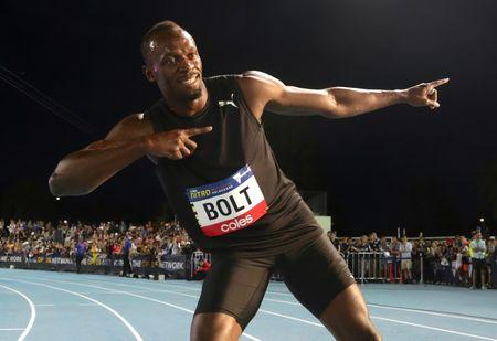 Jamaica's Olympic champion Usain Bolt poses after running during the final night of the Nitro Athletics series at the Lakeside Stadium in Melbourne