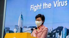 US targets Hong Kong leader but not banks in sanctions report