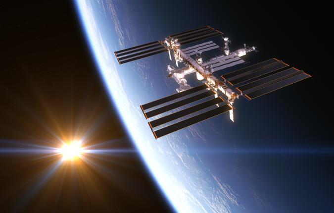 International Space Station On Background Of Rising Sun. 3D Illustration.