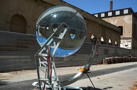 Spherical glass lens concentrates sunlight by up to 10,000 times, boosts solar cell efficiency