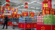 China's Grocery Trolls Make Giant Piggy Banks of Walmart and Carrefour