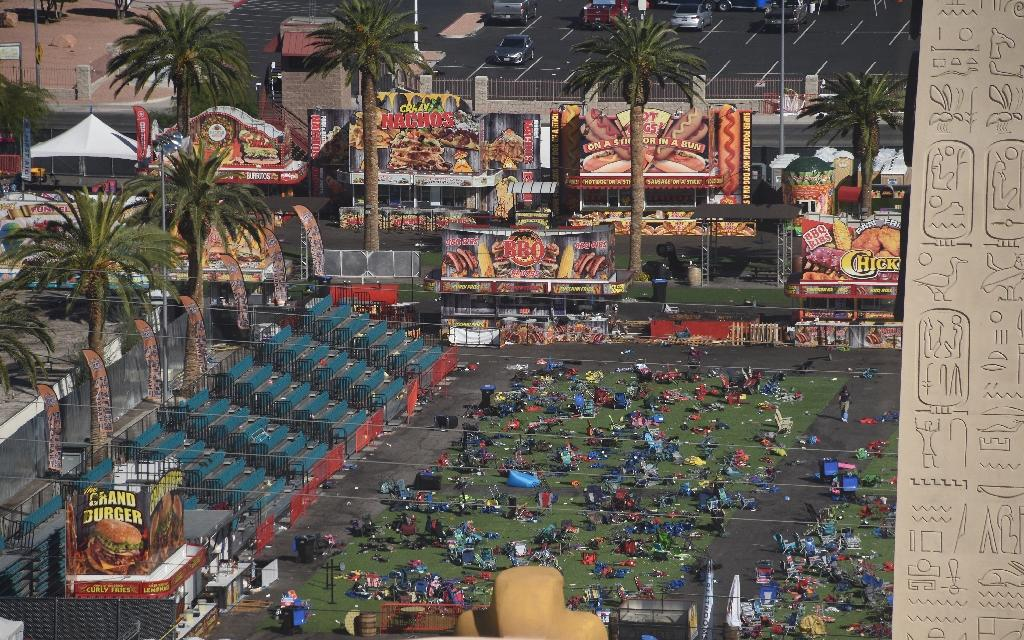 Personal belongings are gathered on the ground at the venue of the Route 91 Harvest Festival after the mass shooting (AFP Photo/Robyn Beck)