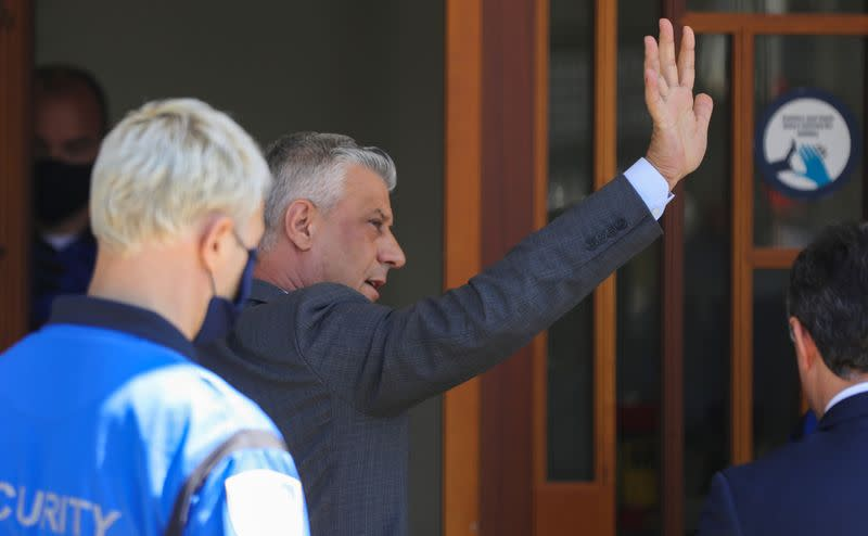 President Hashim Thaci waves as he arrives to be interviewed by war crimes prosecutors after being indicted by a special tribunal, in The Hague