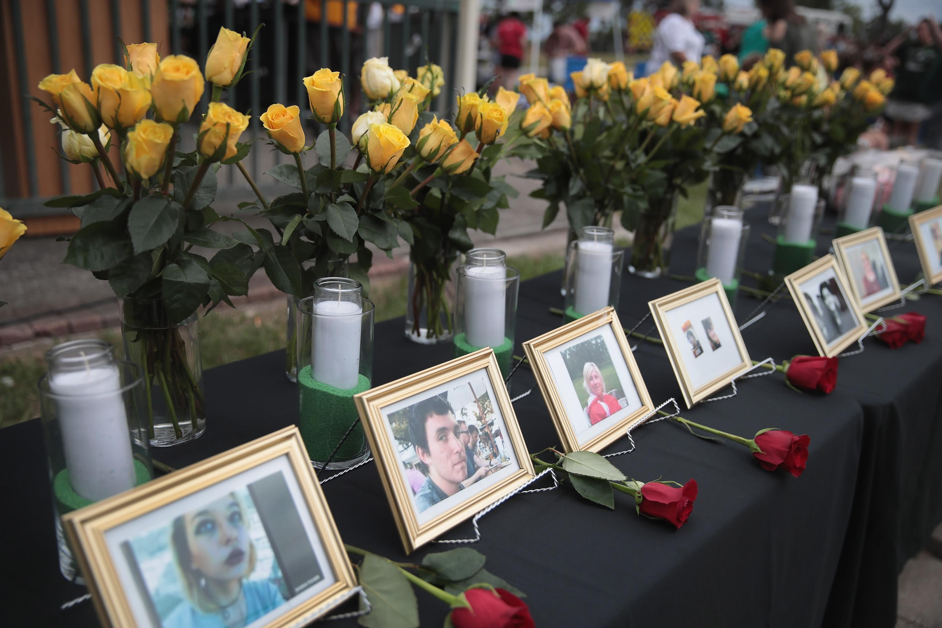 <p>Pictures of victims of the Santa Fe High School shooting are displayed during a prayer vigil at Walter Hall Park on May 20, 2018 in League City, Texas. (Photo: Scott Olson/Getty Images) </p>