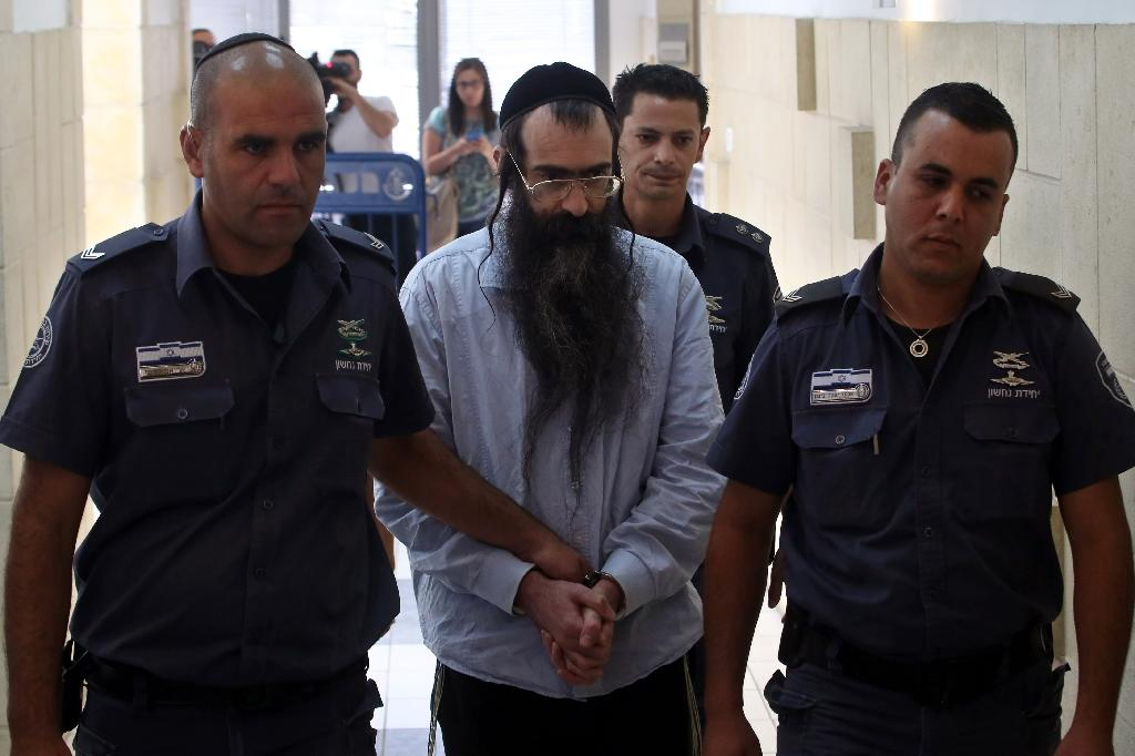 Ultra-Orthodox Jew Yishai Shlissel (C), convicted of killing a 16-year-old Israeli girl during the 2015 Jerusalem Gay Pride parade, is escorted into court in Jerusalem on June 26, 2016 (AFP Photo/Gali Tibbon)