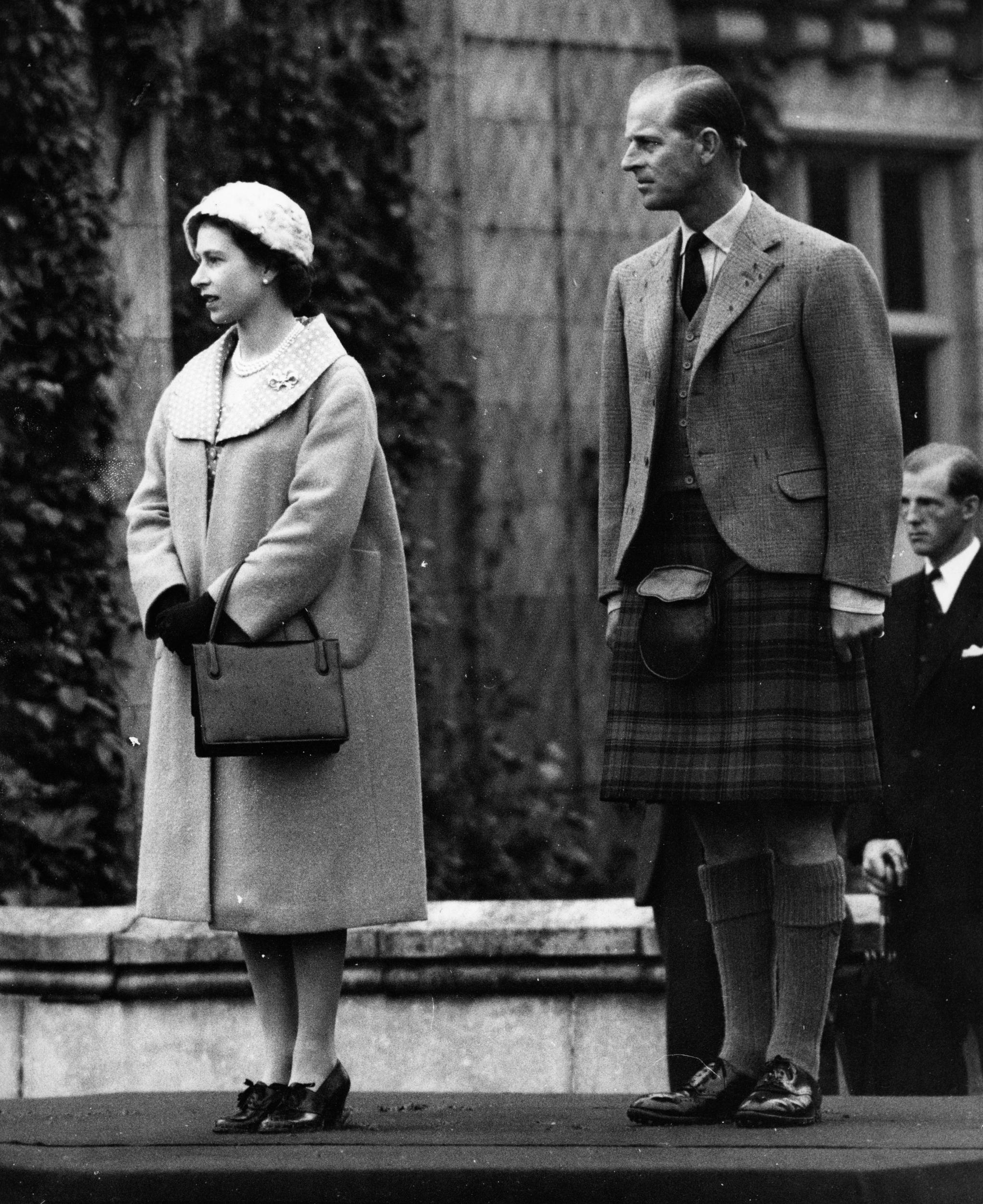 Queen Elizabeth II, with the Duke of Edinburgh, takes the salute as 1,200 members of the Boys Brigade Council march past at Balmoral Castle.