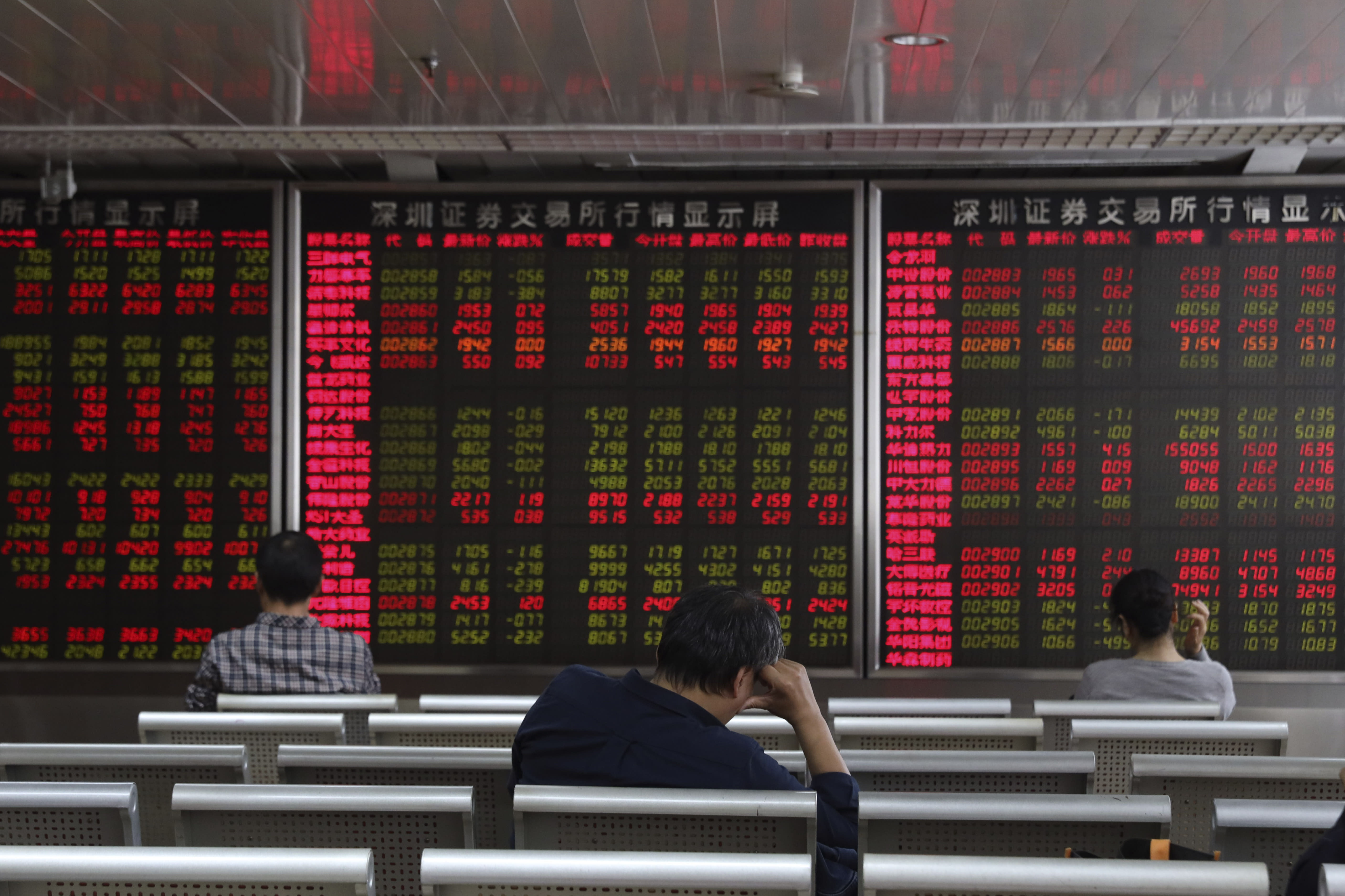 Investors monitor stock prices at a brokerage in Beijing on Wednesday, Oct. 9, 2019. Shares slipped in Asia on Wednesday as tensions between the U.S. and China flared ahead of talks aimed at resolving the trade war between the world's two biggest economies. (AP Photo/Ng Han Guan)