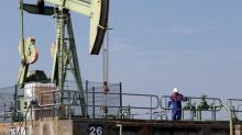 Oil holds gains as Iraq, U.S.-Iran tension raises risks
