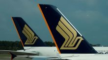 Singapore Airlines posts first annual loss on fuel hedges, virus