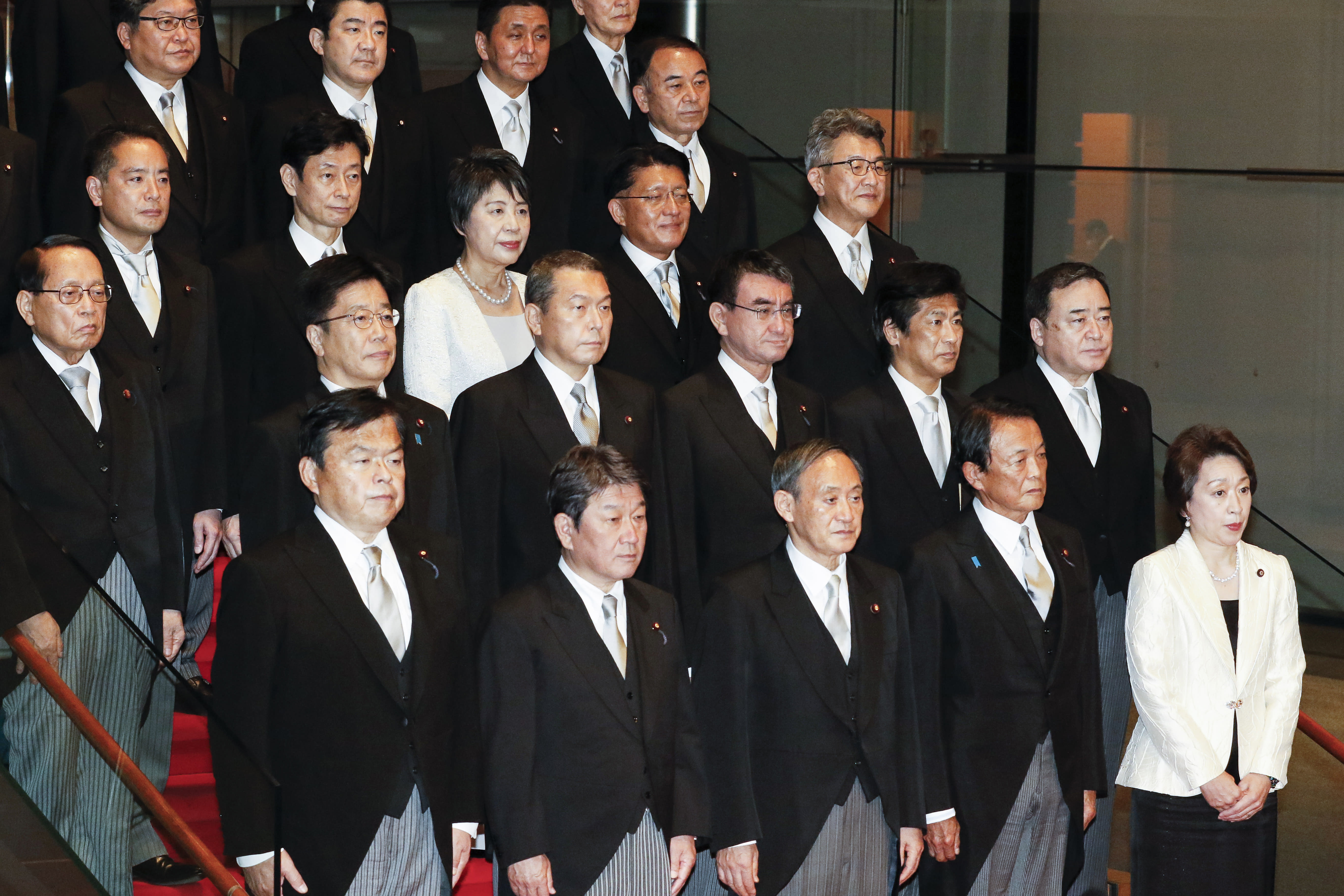 Japan's new Prime Minister Yoshihide Suga, center in front row, poses for a group photo with his cabinet members following the first Cabinet meeting at the prime minister's official residence in Tokyo Wednesday, Sept. 16, 2020. Japan's Parliament elected Yoshihide Suga as prime minister Wednesday, replacing long-serving leader Shinzo Abe with his right-hand man.(Rodrigo Reyes Marin/Pool Photo via AP)